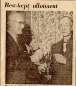 William Pack (left) presents the cup to Mr. Stanley